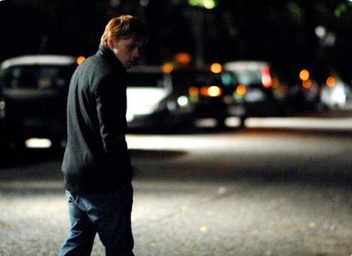 Rupert Grint interpretando a Malachy