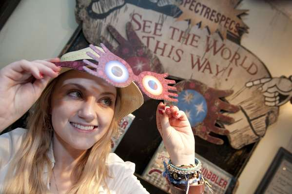 Irish actress Evanna Lynch, known for her role as Luna Lovegood in the Harry Potter film series, stopped to admire the Quibbler display and try on a pair of Spectrespecs at Dervish & Banges at Universal Orlando