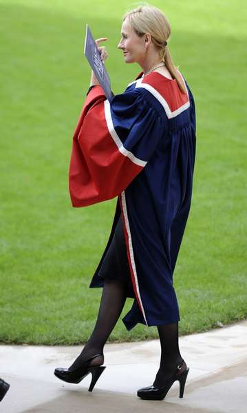 Author JK Rowling walks in the Quadrant after receiving a University Benefactor's award from Britain's Princess Anne at the University of Edinburgh, in Edinburgh