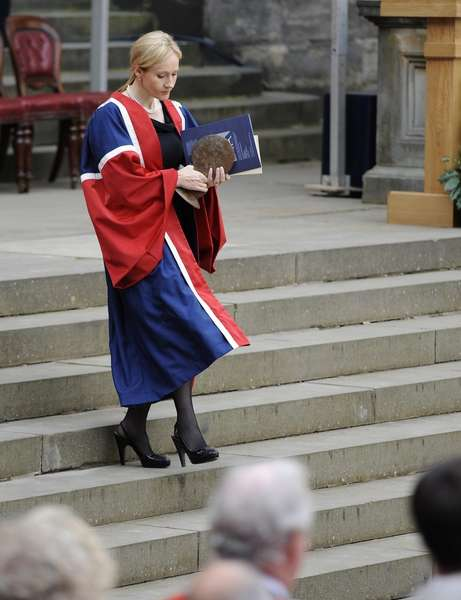 Author JK Rowling holds a University Benefactor's award, after receiving it from Britain's Princess Anne at the University of Edinburgh, in Edinburgh
