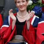Author JK Rowling claps after being awar